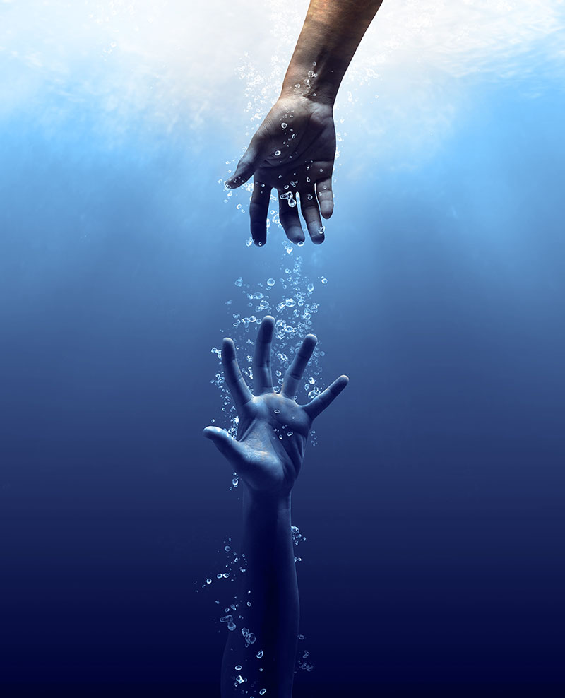 hand drown in the water looking for help
